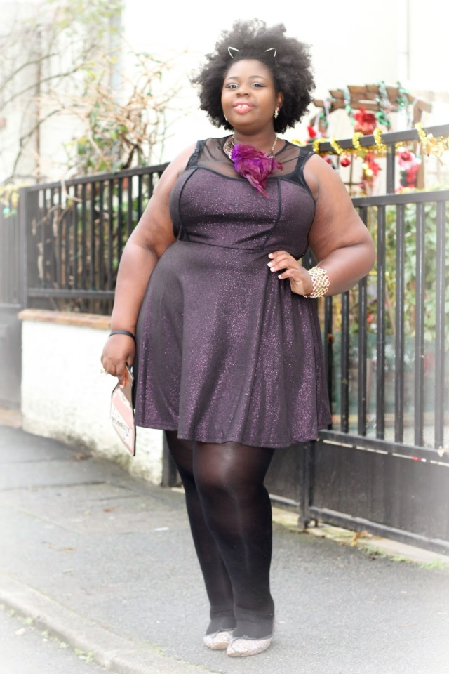 plus size holiday outfit purple and black shimmery dress with cat ear headband