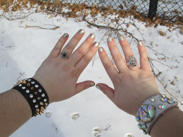 closeup of hands with rings and rhinestone wristbands