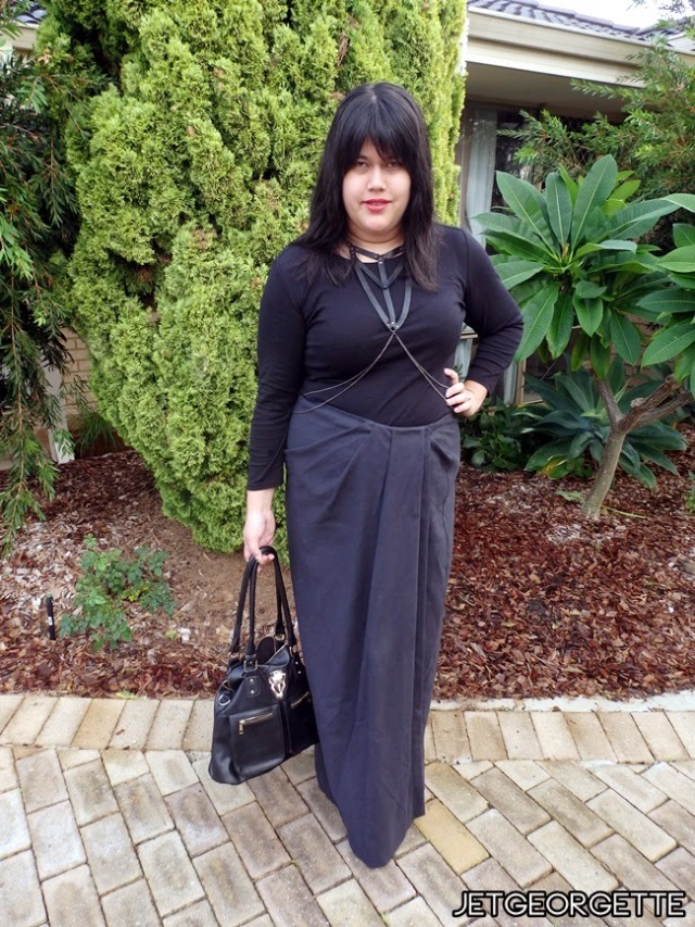 plus size goth outfit with long black skirt and harness