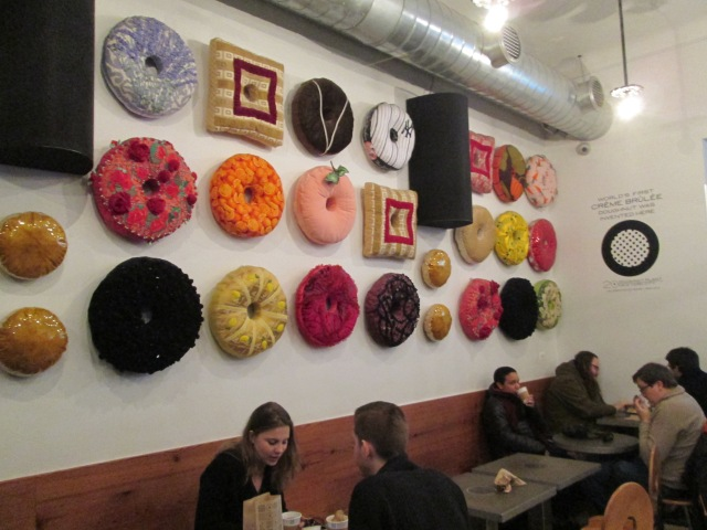 donut store with fabric donuts on the wall