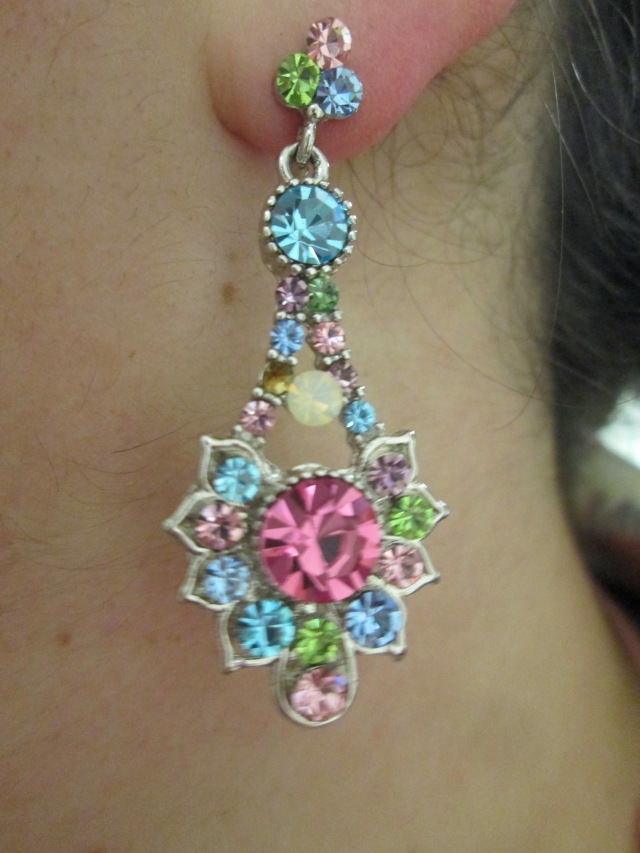 close-up of colorful rhinestone earring