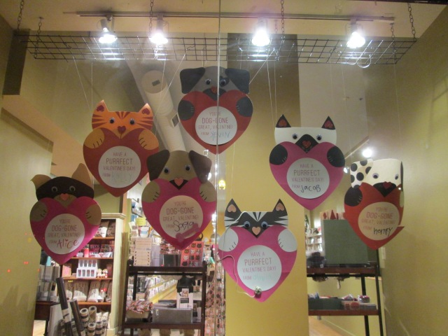 puppy and kitty valentines hanging in store window