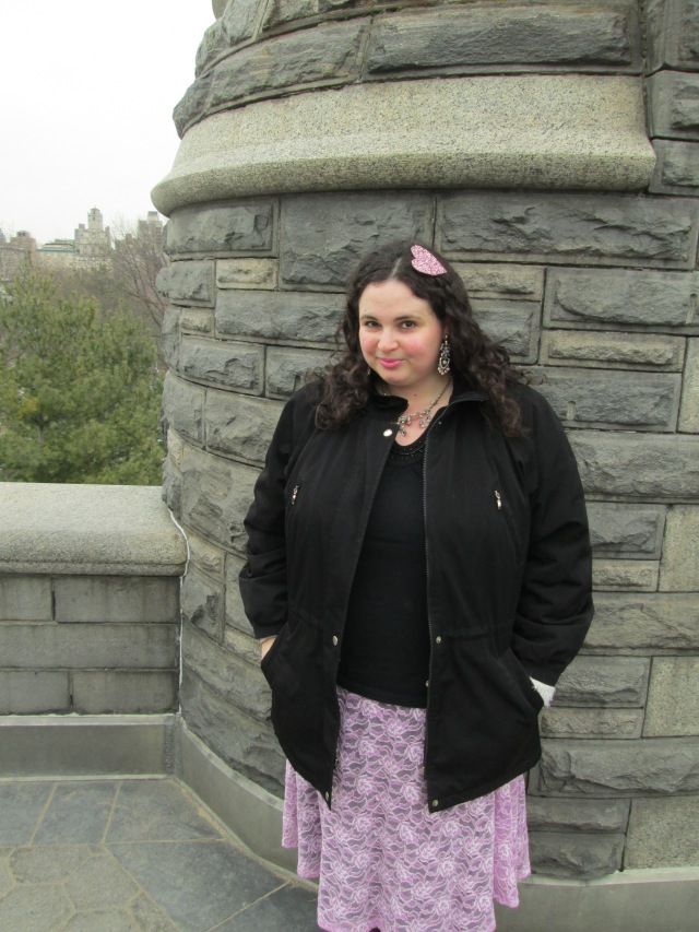 plus size outfit picture black top and pink lace skirt